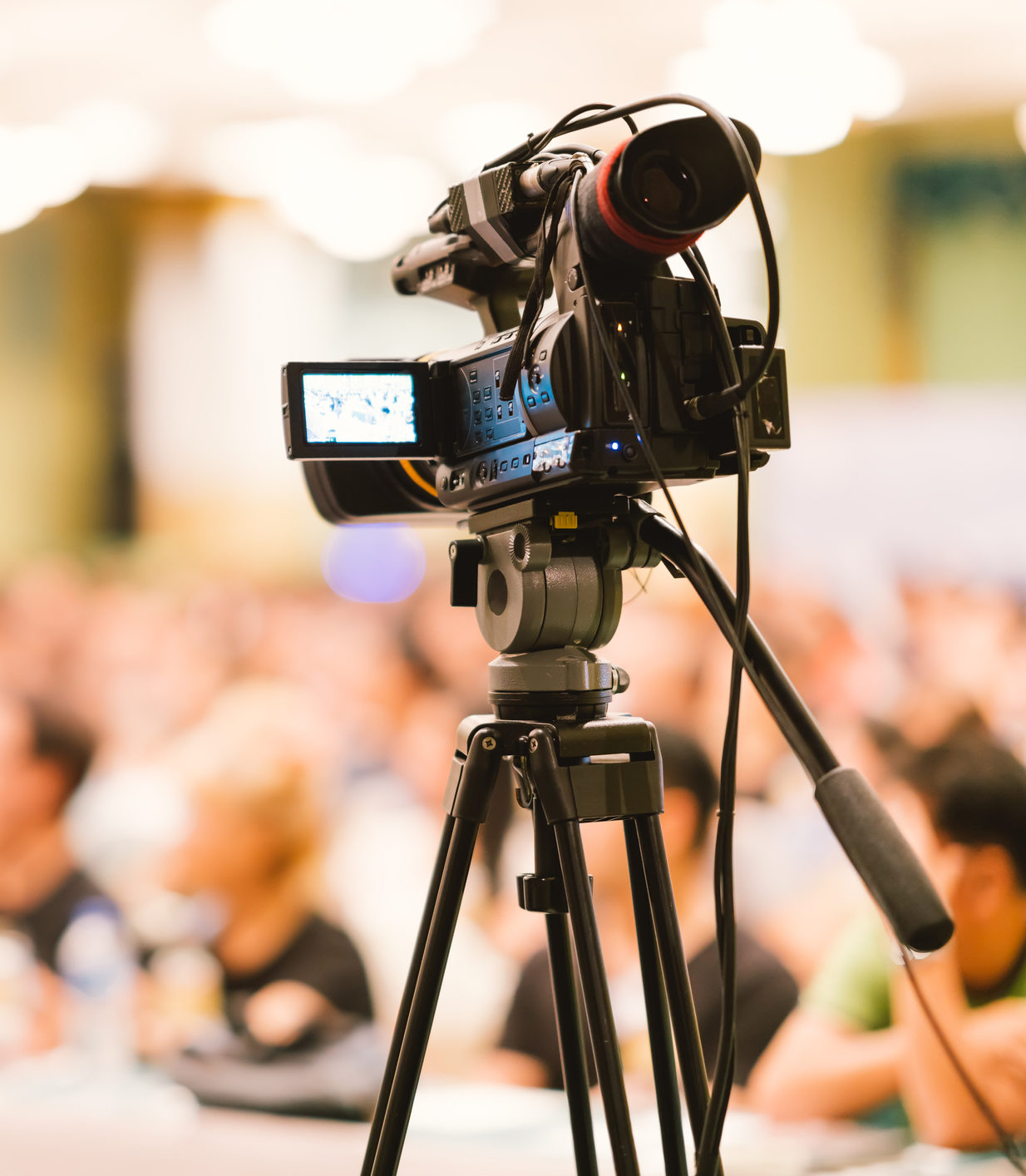 Video camera set record audience in conference hall seminar event. Company meeting, exhibition convention center, corporate announcement, public speaker, journalism industry, or news reporter concept