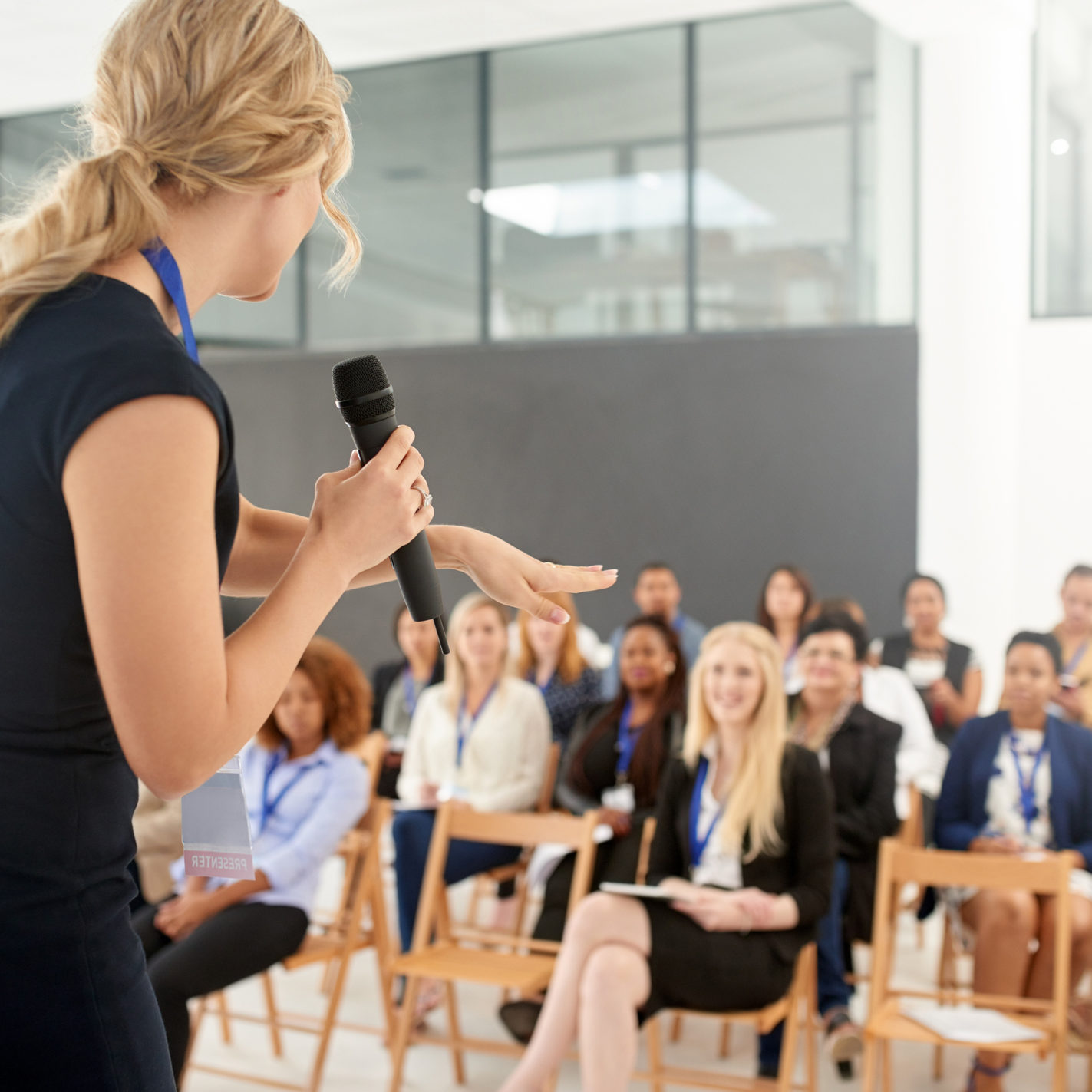 Shot of a young businesswoman delivering a presentation at a conference